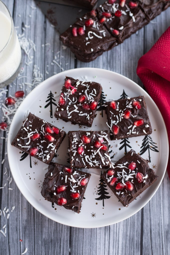 Overhead view of Peppermint Mocha Fudge Avocado Brownies on a white Christmas plate.