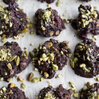 Overhead view of Cranberry Pistachio Cocoa Cookies on a baking sheet.