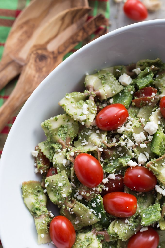 Overhead view of Festive Pesto Pasta Salad in a white bowl.