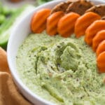 Up-close view of Cilantro Jalapeno Edamame Hummus in a white bowl.