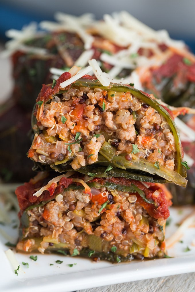 Up-close side view of Turkey Stuffed Collard Greens on a white plate.