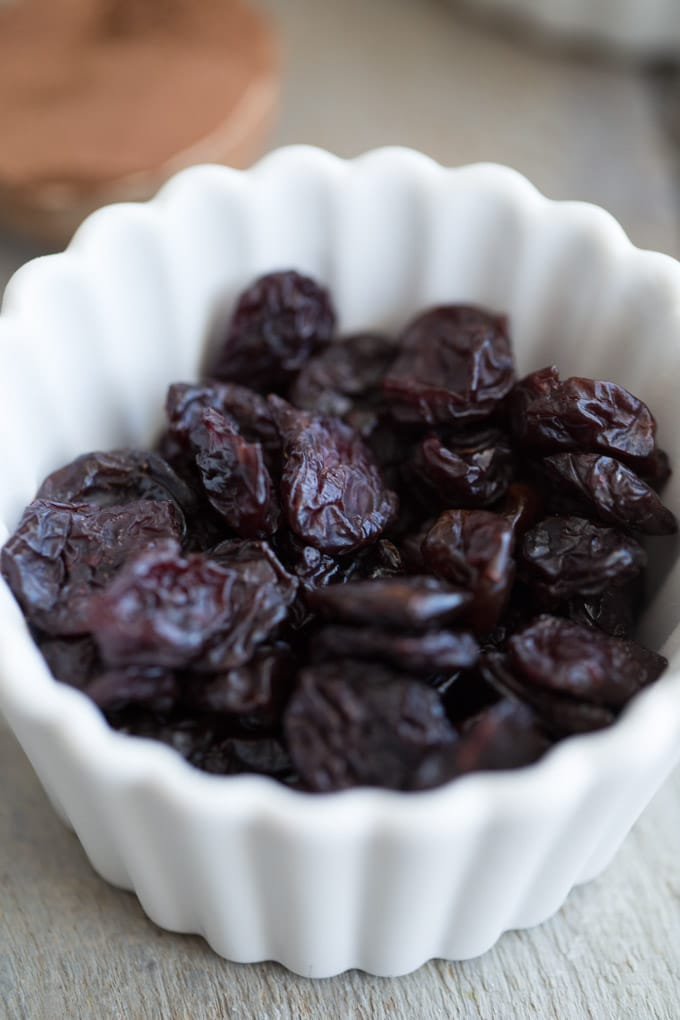 Dried cherries in a white dish.