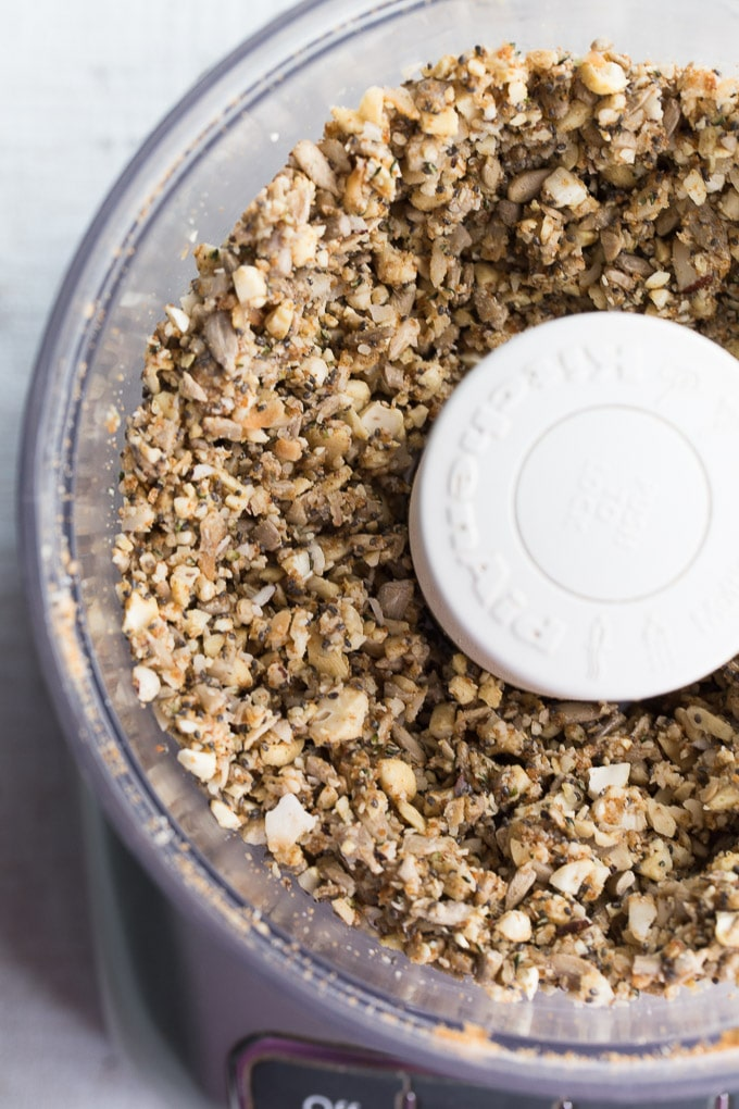 Up-close view of Coconut Cashew Crunch Grain-Free Granola blended together in a food processor.