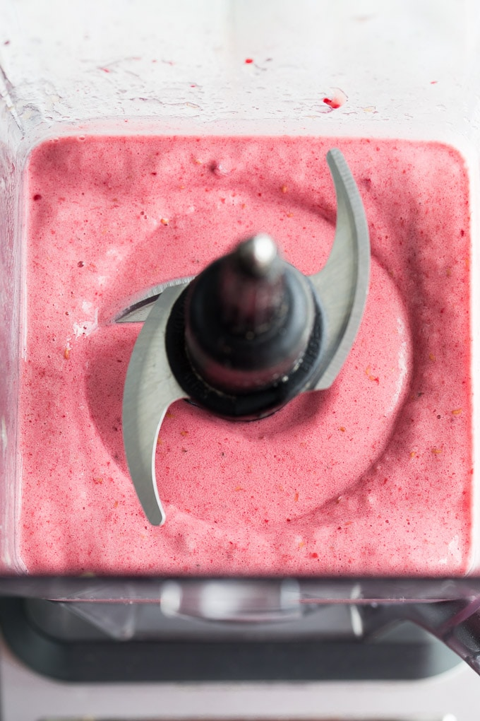 Overhead view of nice cream ingredients blended together in the blender.