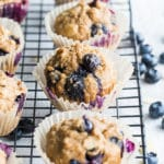 Blueberry Vanilla Almond Overnight Oatmeal Muffins cooling on a wire rack.