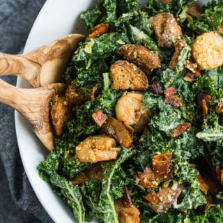 Overhead view of Kale Caesar Salad in a white bowl.