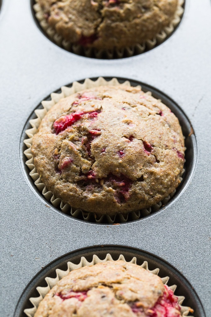 Up-close view of Raspberry Lemon Chia Buckwheat Muffins in a muffin pan.
