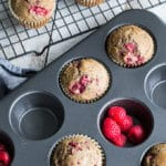 Overhead view of Raspberry Lemon Chia Buckwheat Muffins in a muffin pan and on a cooling rack.