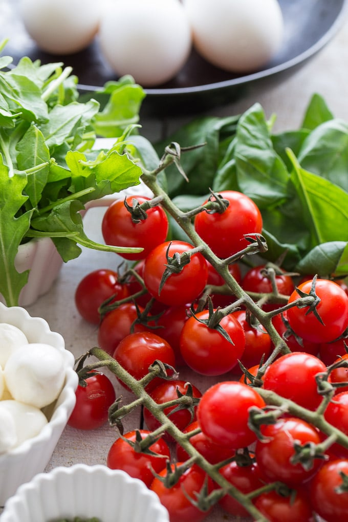 Up-close view of ingredients for Tomato, Arugula and Mozzarella Quiche.