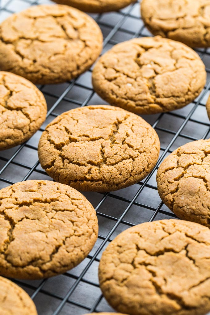 Up-close view of Chewy Ginger Cookies cooling on a wire rack.