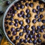 Overhead view of Rosemary Grape Ricotta Cake in a springform pan.