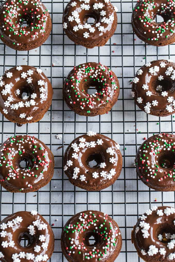 Overhead view of Gingerbread Protein Donuts with Chocolate Glaze arranged on a wire rack.