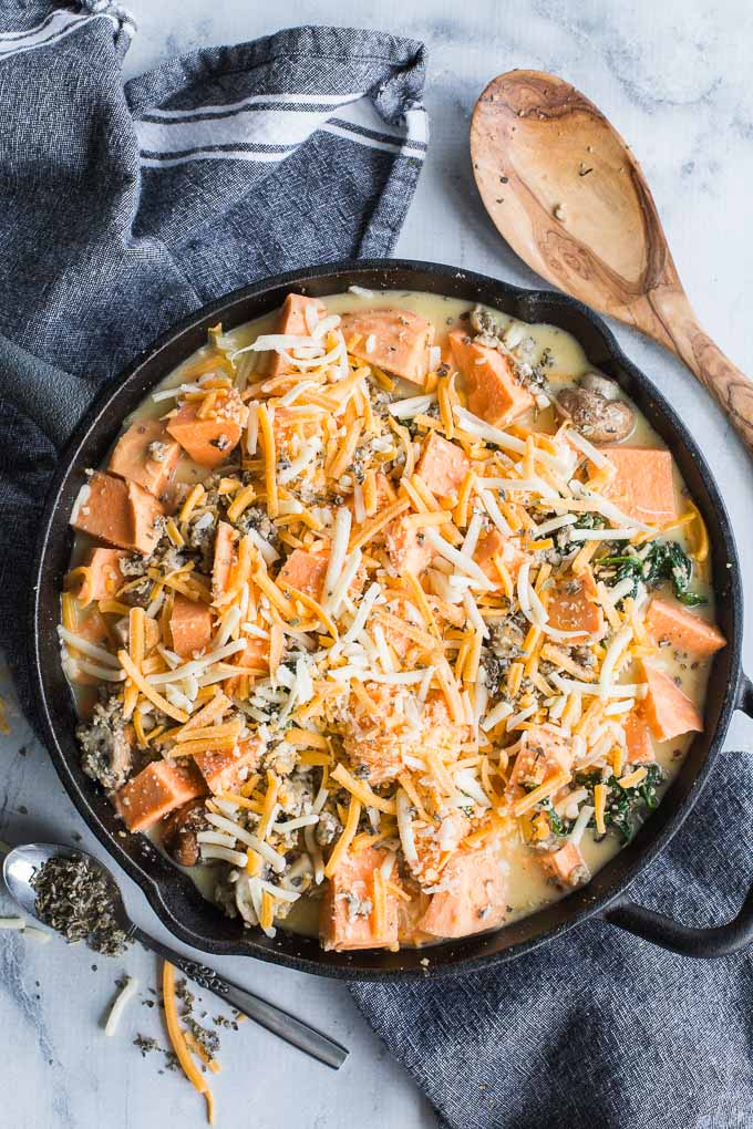 Overhead view of Sweet Potato Turkey Egg Bake assembled in a cast iron skillet.