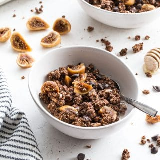 Chocolate Fig Grain-Free Granola in white bowls on a white surface.