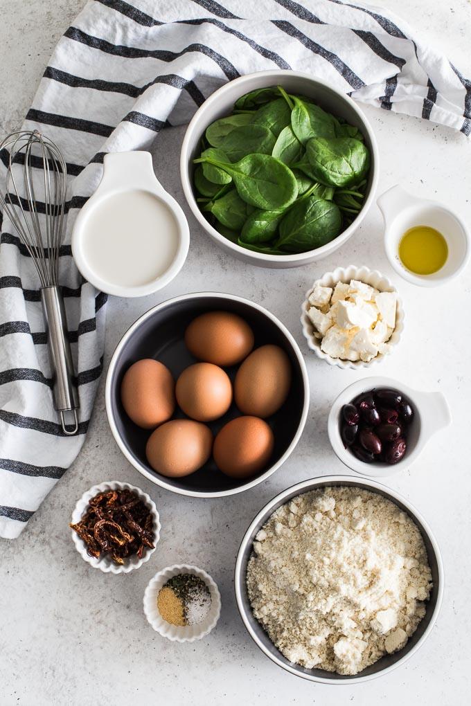 Overhead view of ingredients to make Mediterranean Quiche.