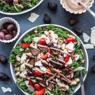 Up-close view of a plate of Tuscan Salad with Farro and Fig Tahini Dressing.