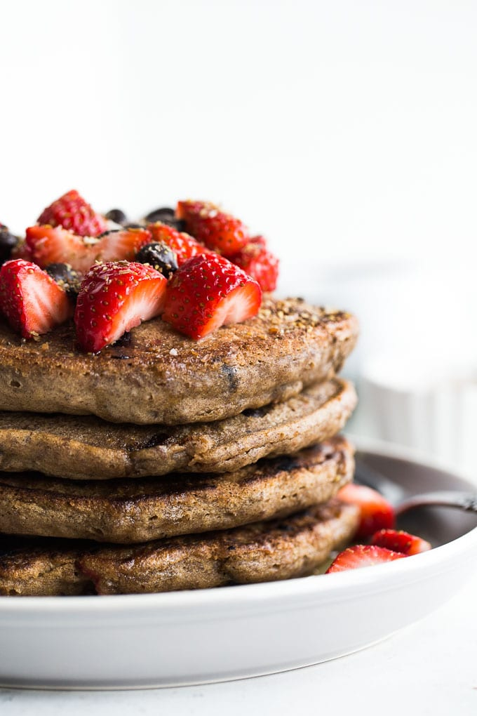 Up-close side view of a stack of Strawberry Chocolate Chip Buckwheat Pancakes.