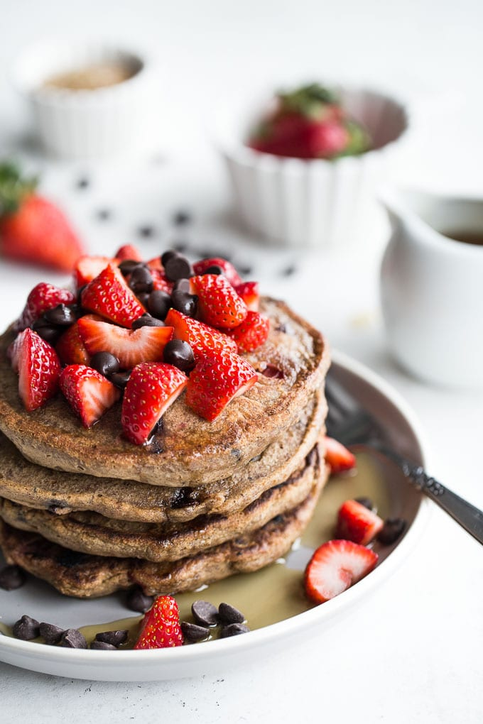 Stack of Strawberry Chocolate Chip Buckwheat Pancakes on a grey plate.