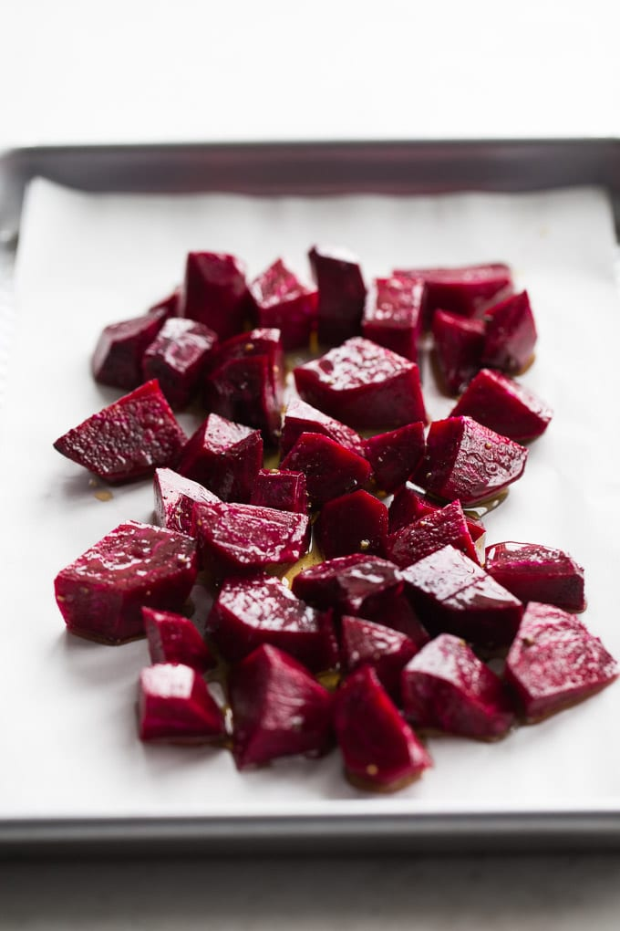 Side view of chopped beets on a baking sheet.