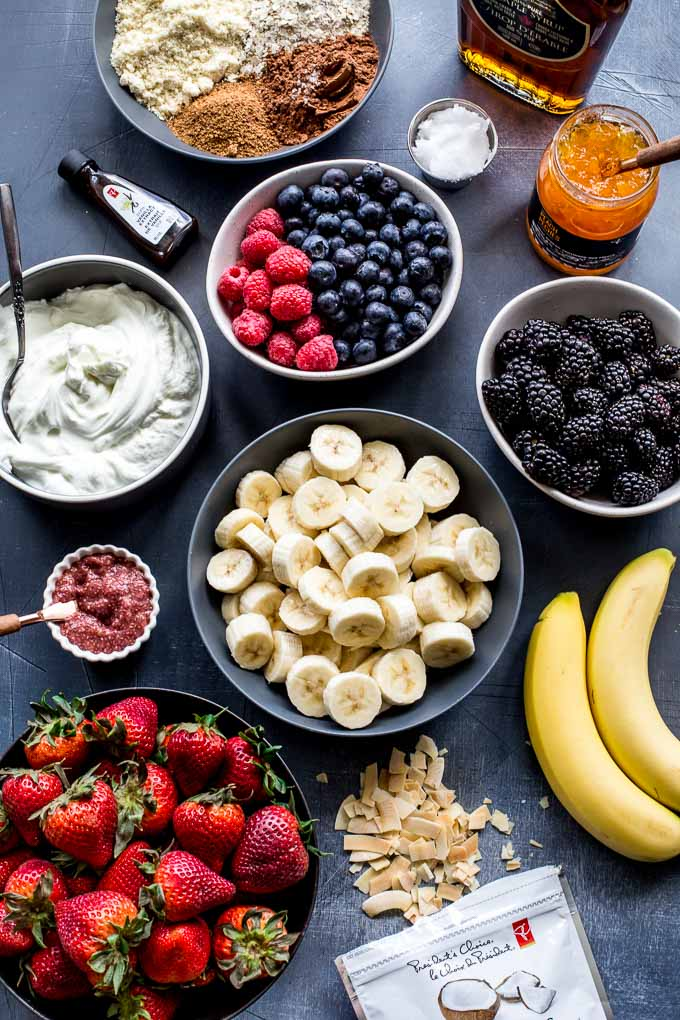 Overhead view of ingredients to make mini fruit tarts.