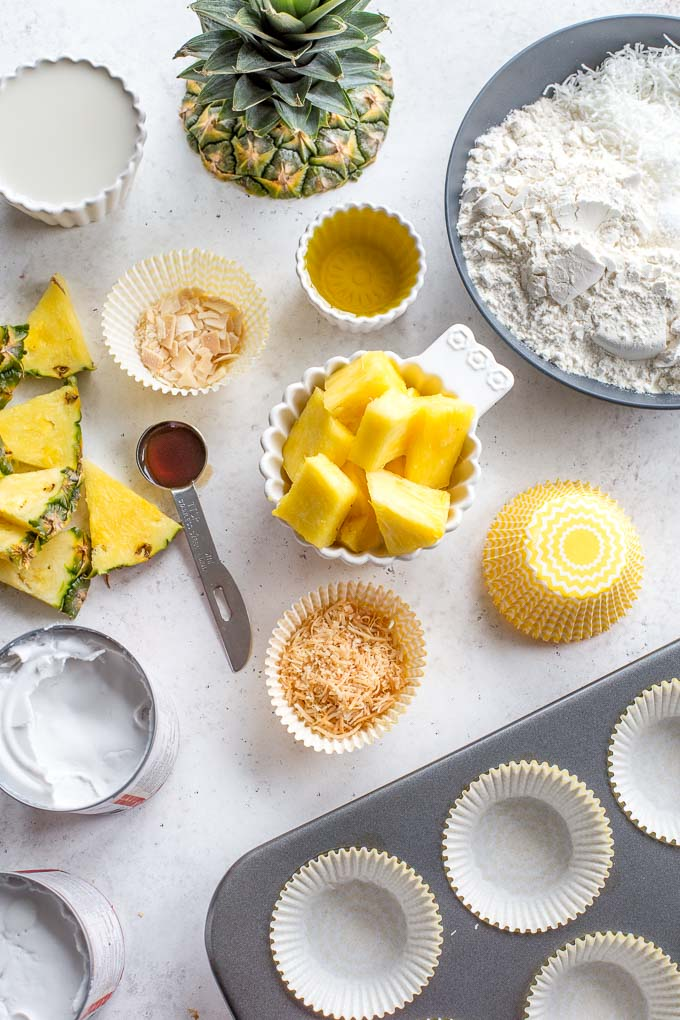 Overhead view of ingredients to make pineapple coconut cupcakes.