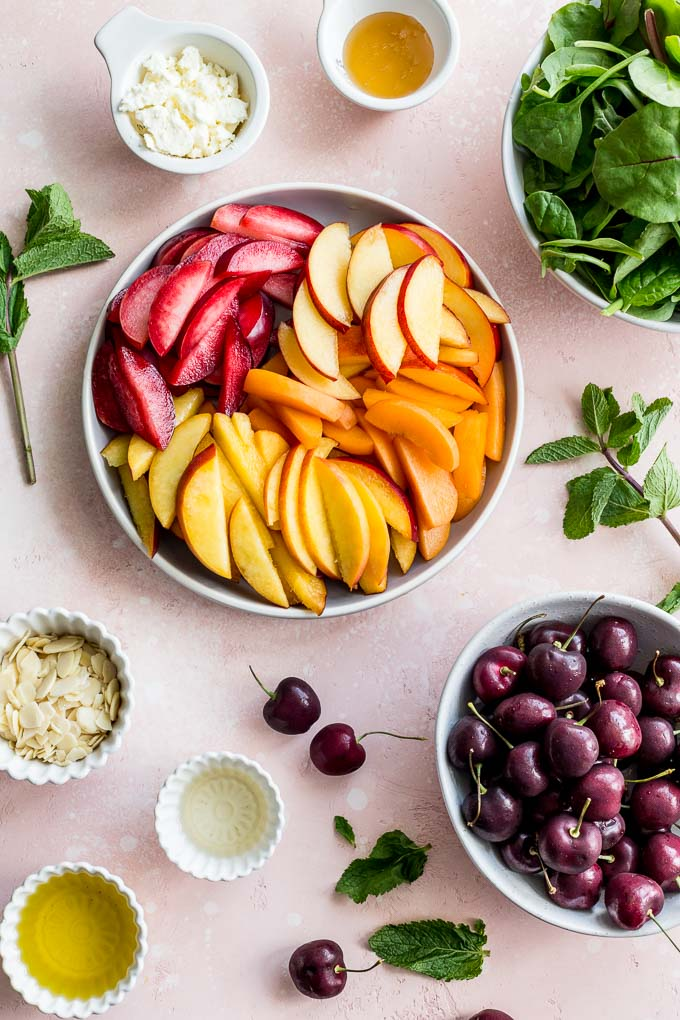 Overhead view on ingredients to make stone fruit salad and mint honey vinaigrette.