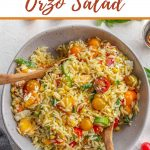 Pinterest image of a summer orzo salad in a large bowl.