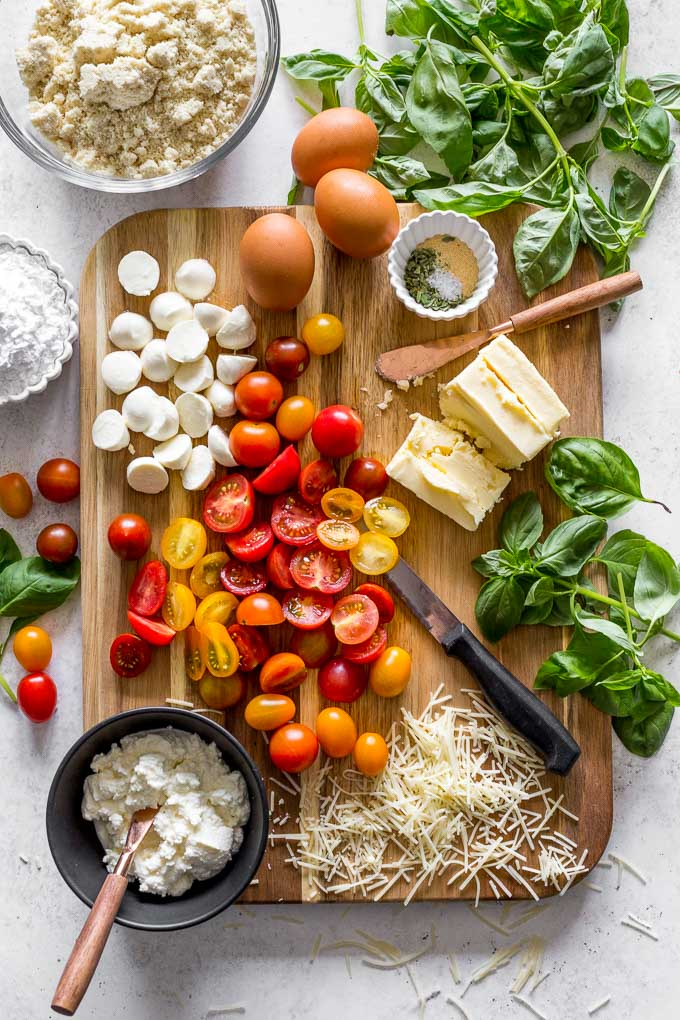 Overhead view of ingredients to make three cheese tomato galette.