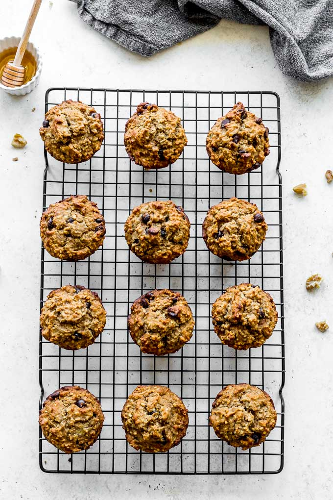 Gluten-free version of banana muffins with chocolate chips cooling on a wire rack.