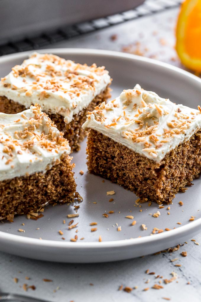 Up-close view of Chai Spice Cake with Orange Cardamom Frosting on a plate.