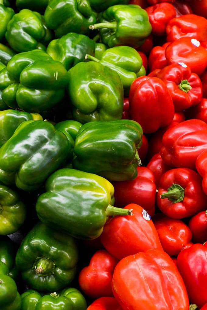 Display of red and green bell peppers.