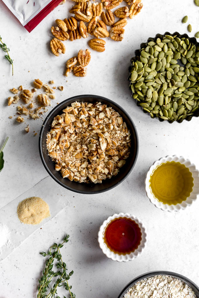 Ingredients to make savory granola arranged on a white surface.