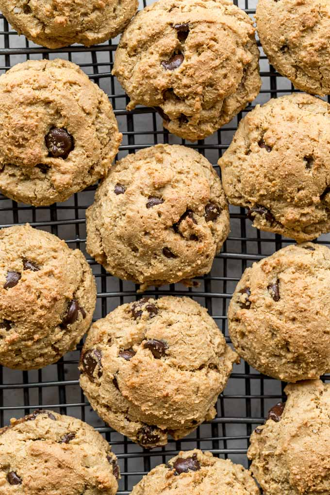 Up-close view of Cookie Butter Chocolate Chip Cookies cooling on a wire rack.