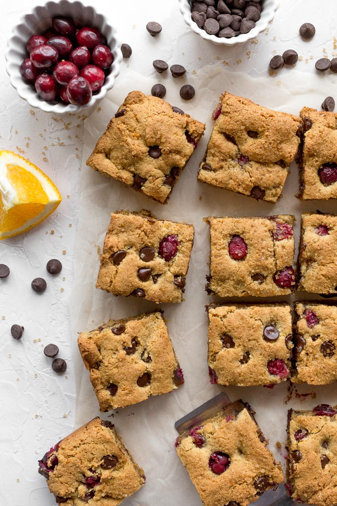 Overhead view of cranberry chocolate chip cookies cut into squares.