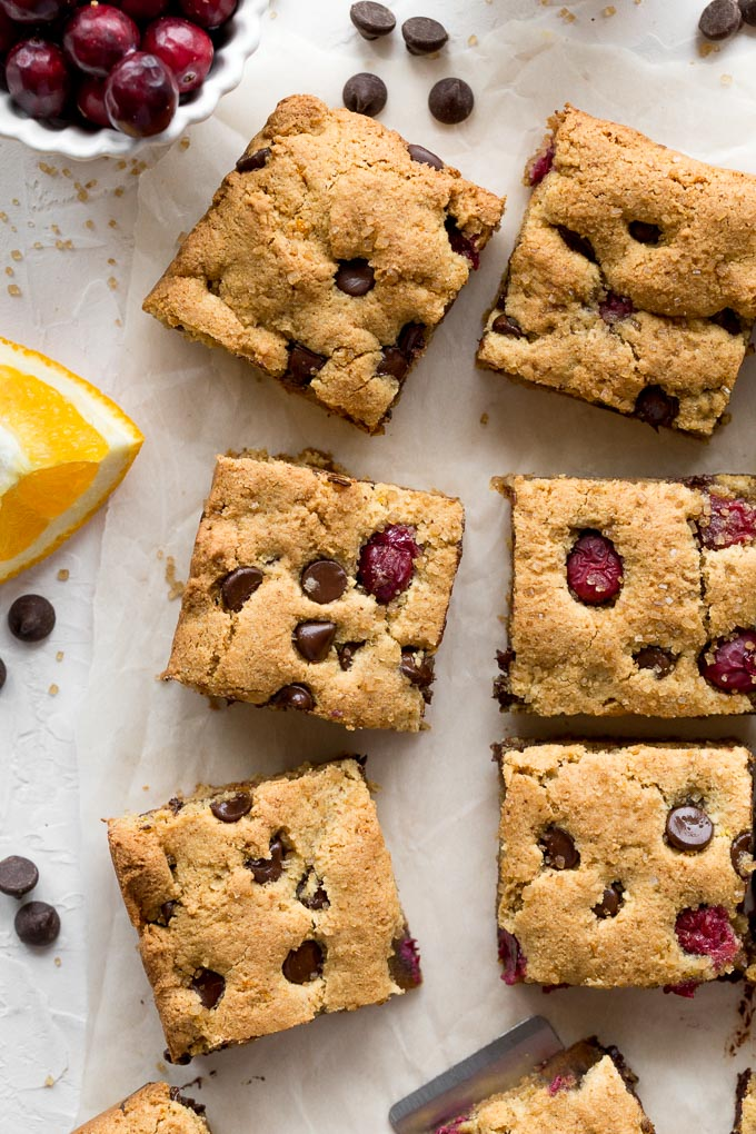 Up-close overhead view of almond flour cranberry cookies cut into squares.