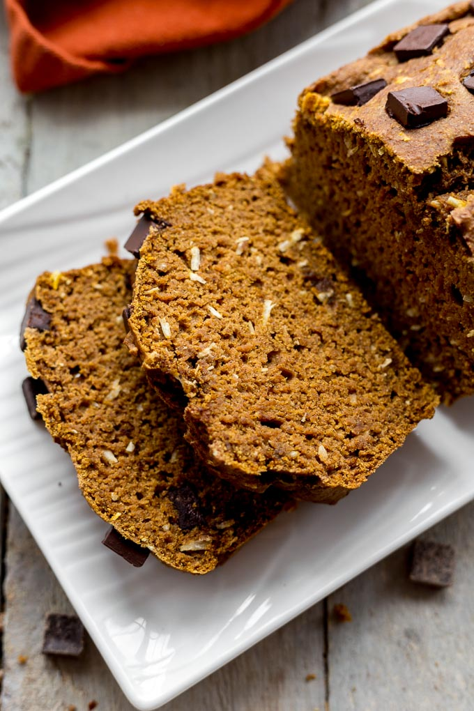 Up-close view of slices of Healthy Pumpkin Bread on a white plate.