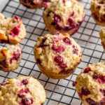 Partridgeberry Muffins cooling on a wire rack.