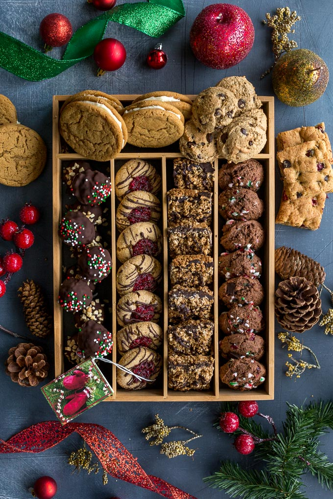 Overhead view of a holiday cookie box arranged on a dark surface.
