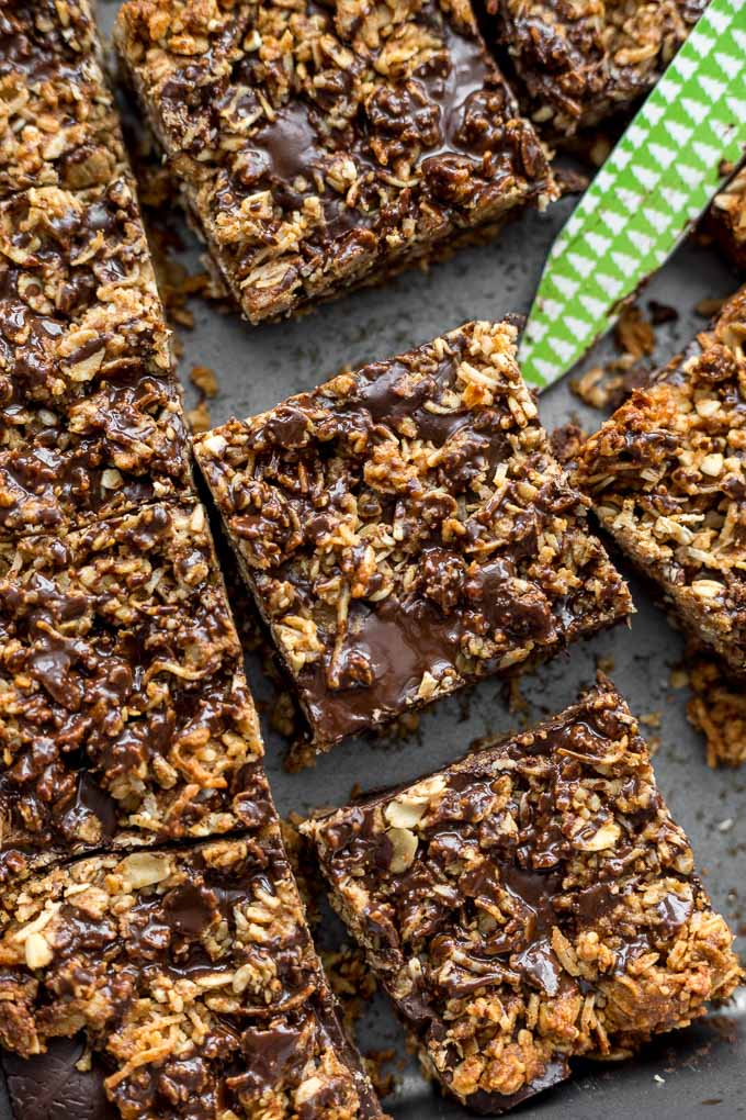 Up-close view of chocolate oatmeal bars in a pan and cut into squares.