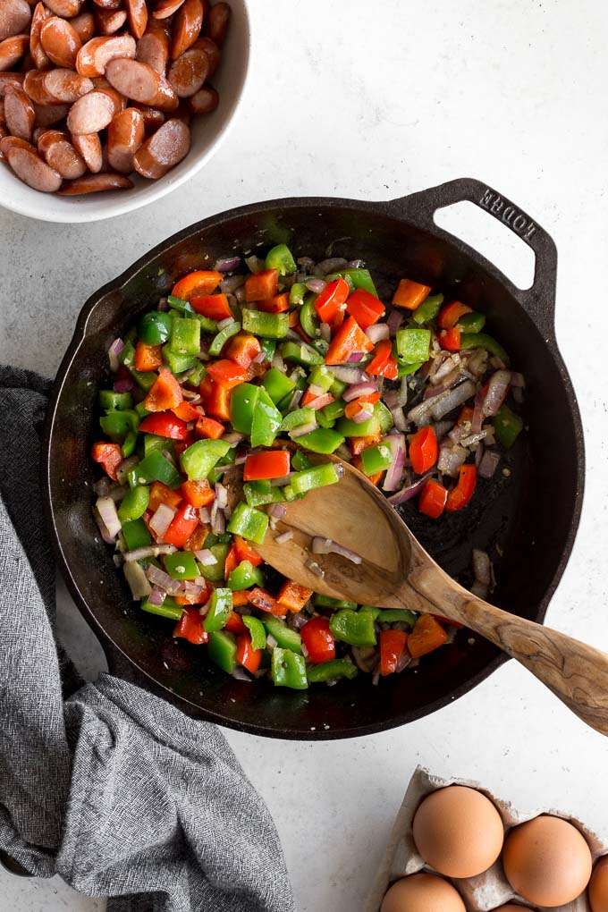Peppers and onions sauteed in a cast iron skillet.