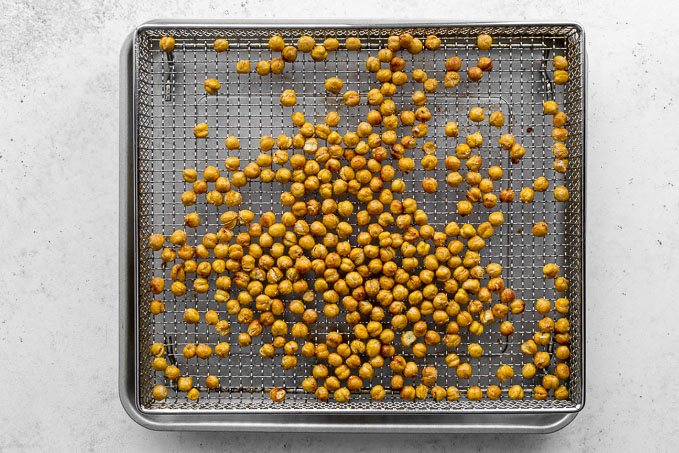 Air fried chickpeas cooling in the air fryer basket.