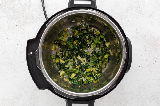 Soup ingredients being sauteed in the Instant Pot.