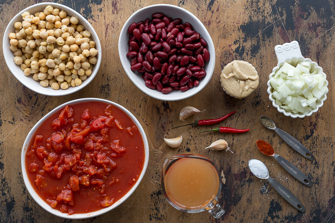 Ingredients to make Tomato Chickpea Soup arranged in individual dishes.