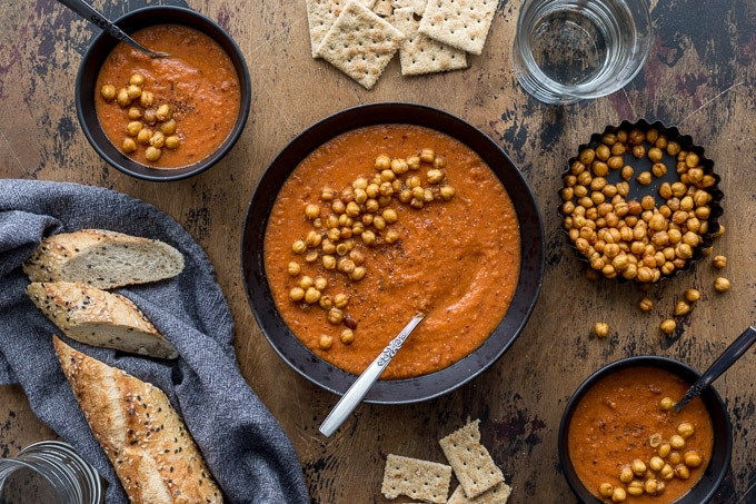 Tomato Chickpea Soup in black bowls and topped with crispy chickpeas.