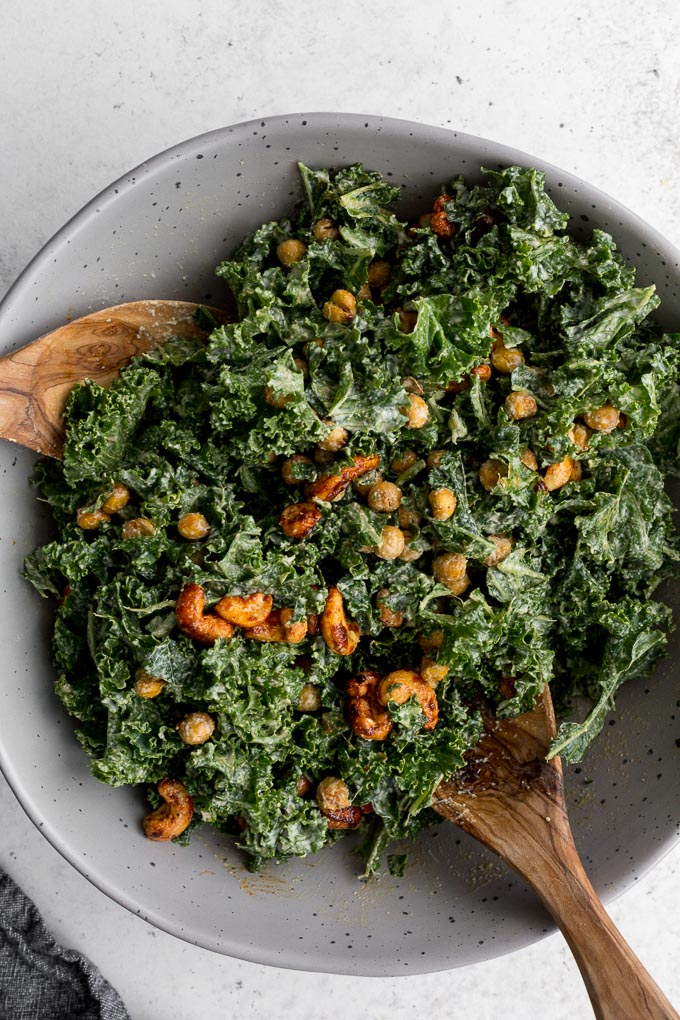 Up-close view of kale caesar salad in a large bowl.