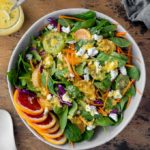 Overhead view of a large bowl of Winter Salad with Citrus Honey Dressing.