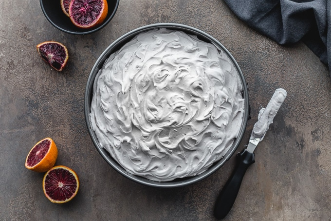 Overhead view of blood orange chocolate cake topped with coconut milk frosting.