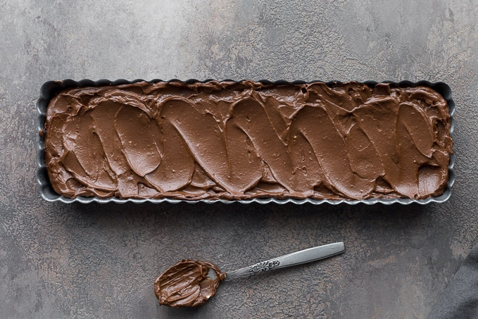 Chocolate whiskey filling spread over the tart crust.