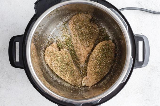Seasoned chicken breasts in the Instant Pot.
