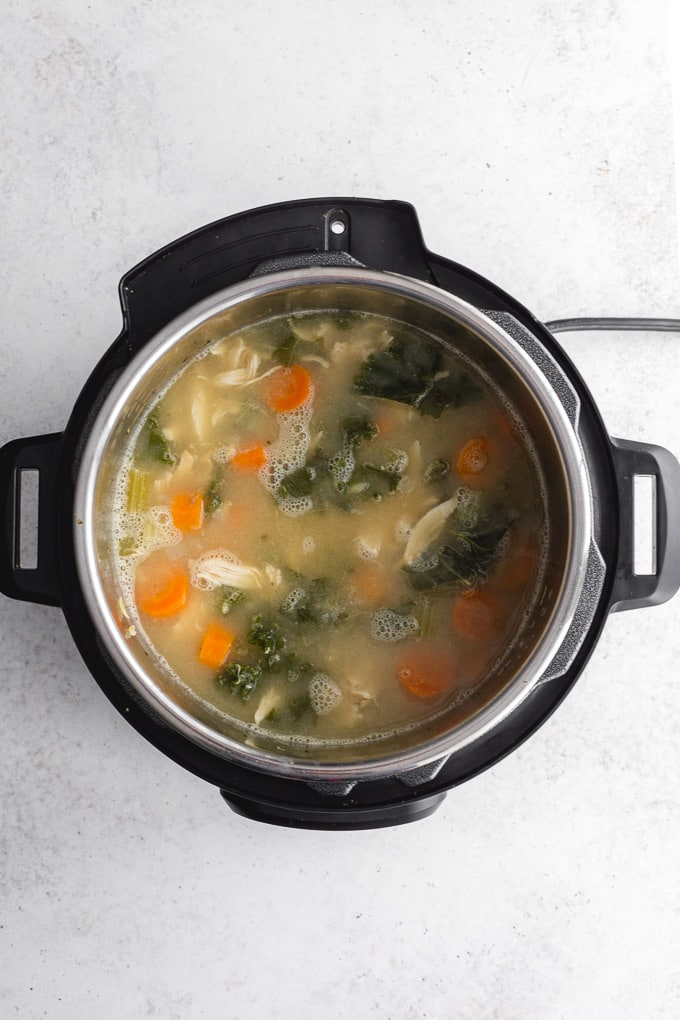 Overhead view of lemon chicken soup with orzo in the Instant Pot.